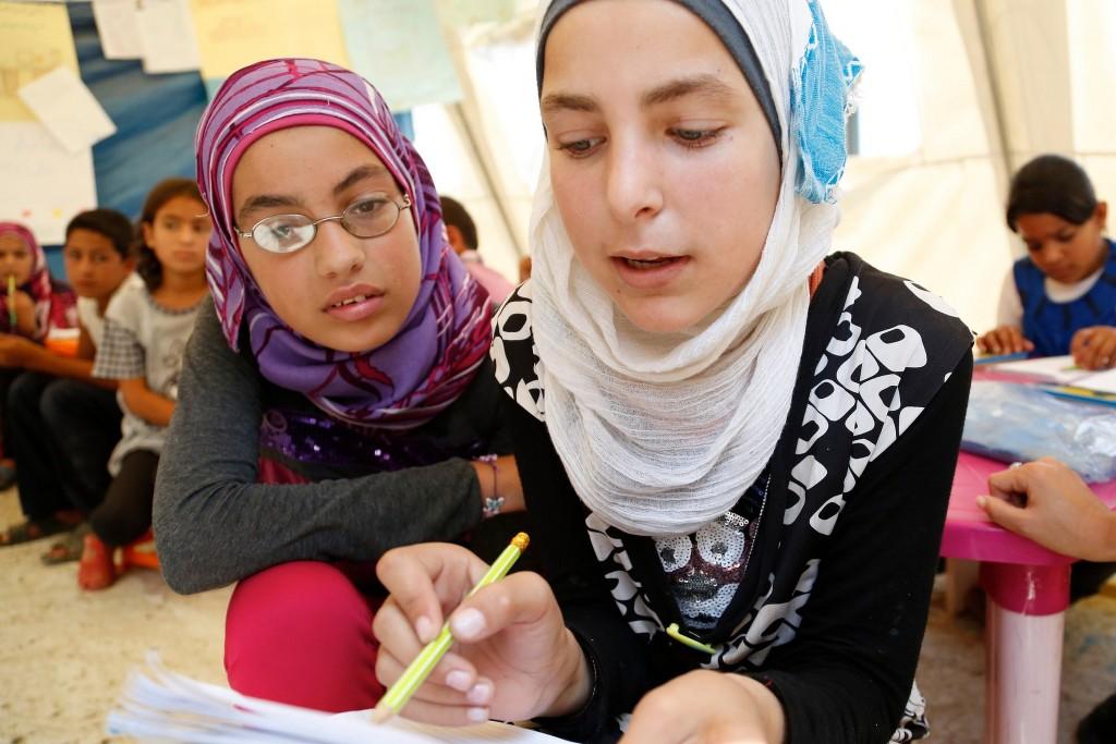 Unterrricht für syrische Mädchen in einem Flüchtlingslager. Foto: DFID / flickr (CC BY 2.0)