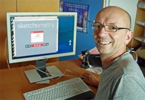 """Prof. Alfred Wassermann, Lehrstuhl für Mathematik und ihre Didaktik, vor der Homepage der interaktiven Geometrie-Software """"Sketchometry"""". Foto: Chr. Wißler"""